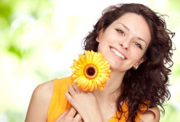 beautiful orange young brunette girl expression portrait with daisy flower