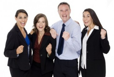 A successful business team celebrate their achievements